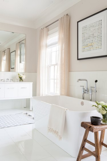 neutral toned bathroom with freestanding tub and modern fixtures