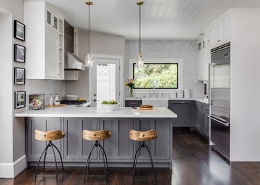 modern white kitchen with gray distressed cabinets