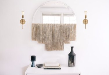 Make a mirror fancy with some fringe.