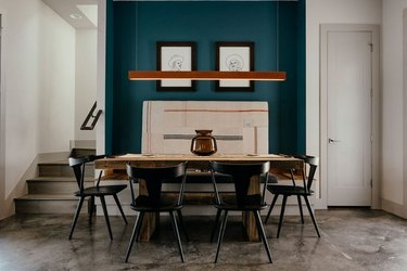 dining room with green accent wall