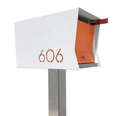 Orange and white midcentury modern mailbox with modern house numbers