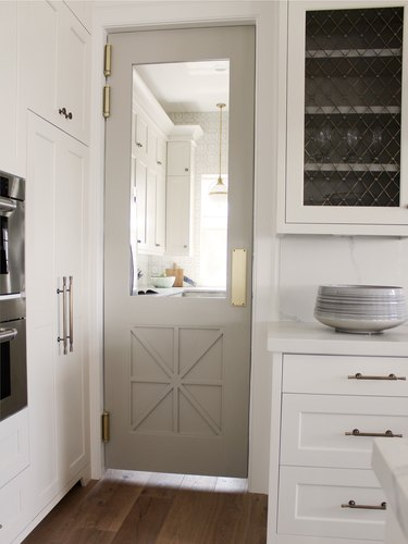 Gray kitchen color idea with gray pantry door and white cabinets