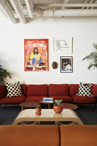 photo of couches and paintings on the wall