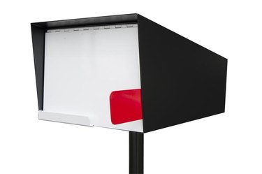 Red, white, and black midcentury modern mailbox with classic details