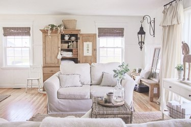 farmhouse-style living room with canvas/linen curtains