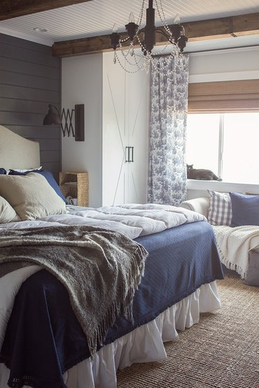 blue-and-white toile curtains in bedroom