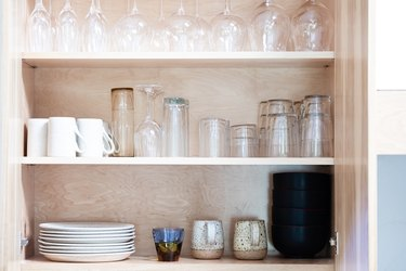 open cabinet with glassware