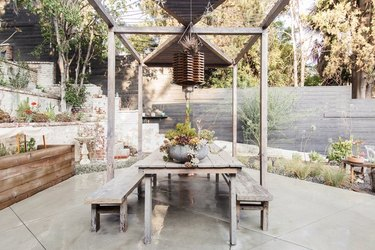 rustic outdoor party idea with dining table and benches