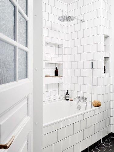 Simple bathroom with white metro tiles
