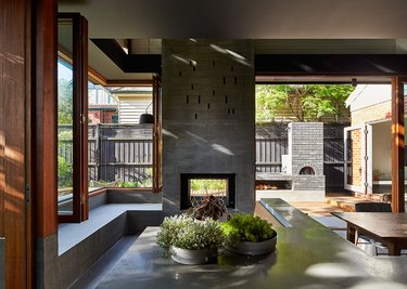 Open layout home with concrete two-sided fireplace