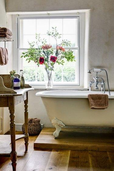 antique bathtub in this modern farmhouse bathroom