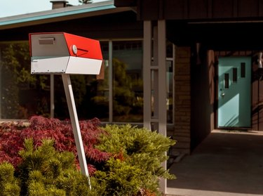 red and white ModBox midcentury modern mailbox in front of house