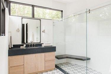 modern bathroom with black countertops