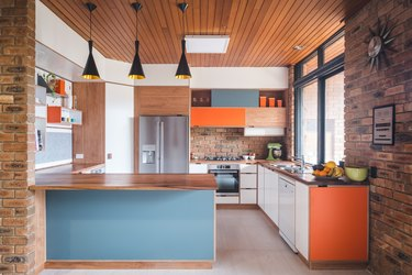 two tone kitchen color idea with orange and blue midcentury kitchen