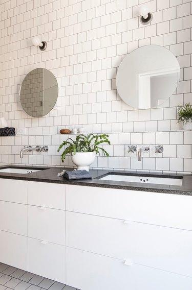 white bathroom with black countertops
