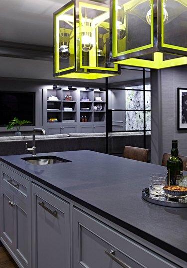 monochromatic basement kitchen with yellow lights