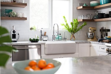 Kitchen with farmhouse sink and marble counter