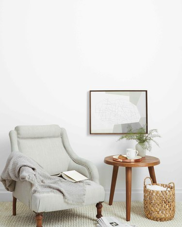 room with gray chair and wood side table