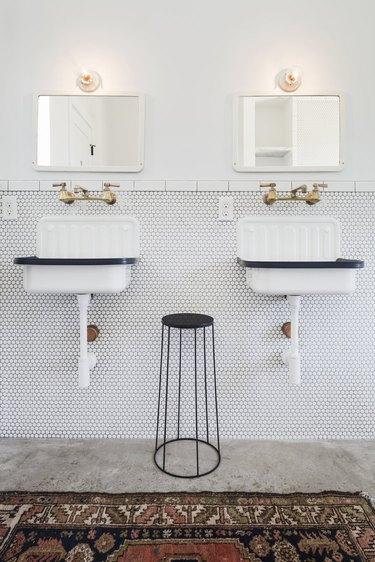 Utilitarian modern farmhouse bathroom with vintage sinks