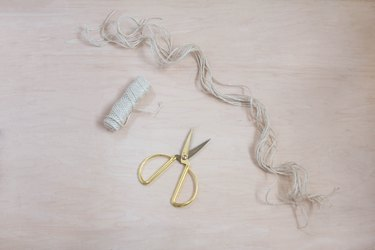 Cutting long strands of twine