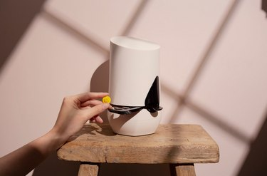 White skincare device with hand inserting pod