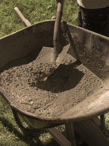 mixing concrete in a wheelbarrow