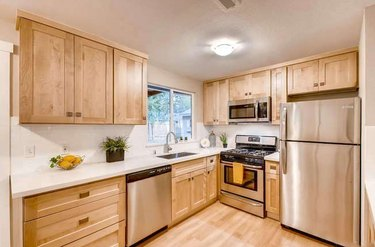 kitchen with natural maple shaker cabinets
