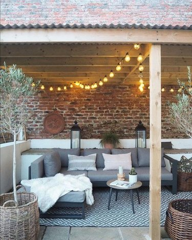 outdoor pergola with globe string lights