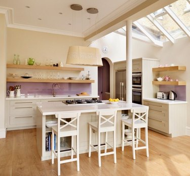 purple kitchen color idea with lilac glass backsplash and wood shelving above