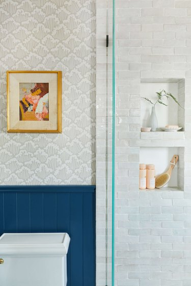 modern shower idea with niches and blue wainscoting