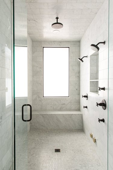 modern shower idea with marble shower with rainfall shower head and marble shower seat