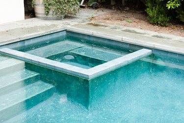 pool with integrated spa, tile wall