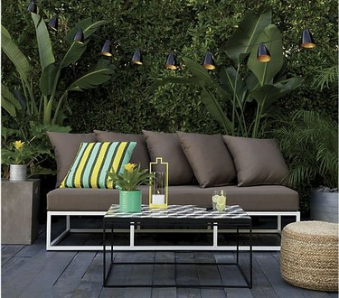 contemporary garden patio with industrial string lights