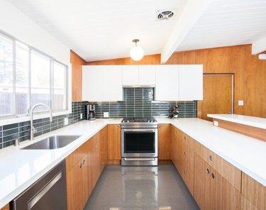 wood midcentury kitchen with shiny vinyl floor