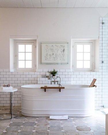 white farmhouse bathroom with a livestock feed trough as bathtub