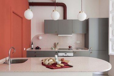two tone kitchen color idea with coral and gray kitchen