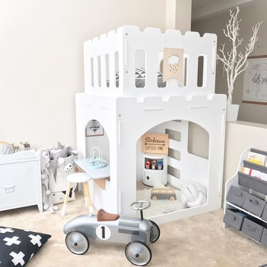 kids playroom idea with two story castle