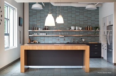 midcentury-inspired kitchen with blue ceramic tile floor