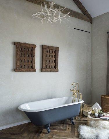 modern farmhouse bathroom with blue clawfoot bathtub