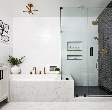 Black tiling in a shower-tub combo