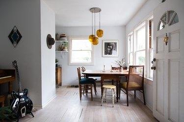 blonde hardwood floor, open view of small kitchen