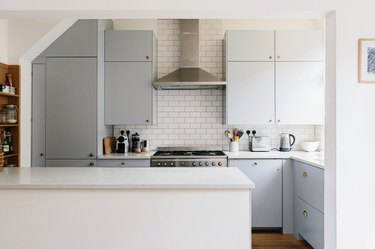 small kitchen, vent hood, island, powder blue cabinets, subway tile