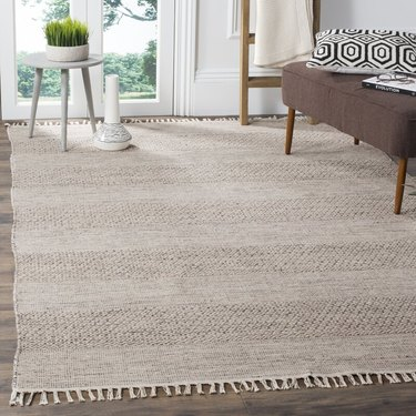natural woven fringed carpet