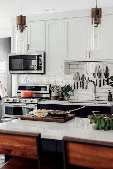 modern bohemian kitchen with subway tile backsplash and double sink
