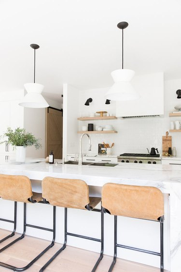 all white kitchen with open shelving and double sink