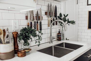 modern kitchen with white subway tile and double sink