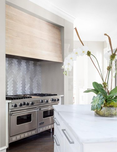 modern kitchen with herringbone pattern metal tile backspalsh