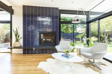 midcentury fireplace with blue fireplace surround