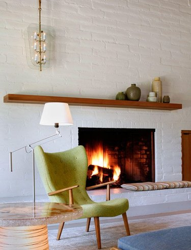 midcentury living room with white brick fireplace