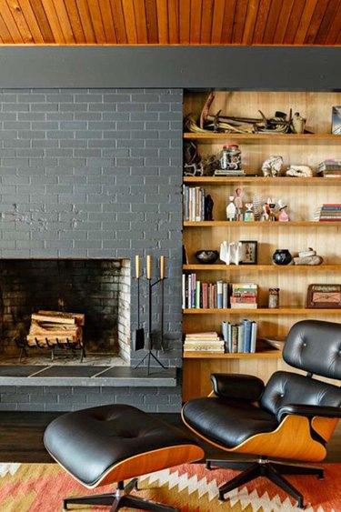 midcentury fireplace with gray brick surround